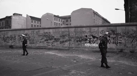 Two soldiers guarding the Berlin Wall